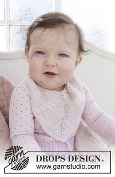 Giggles in Pink - Baby bib with cables, garter stitch and lace pattern. The piece is knitted in DROPS Baby Merino. Free knitted pattern DROPS Baby 29-17