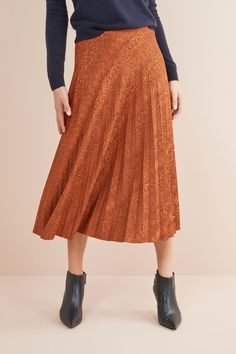09666545b Sway your way through the day with out red zebra print midi skirt. A ...