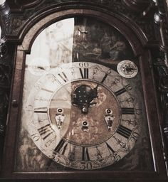 some details of the clocks, with paris his reflection in the left picture