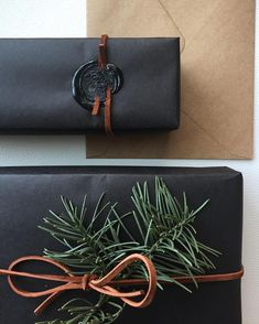 Holiday Inspired Masculine gift wrapping I #BlackGiftWrap I #PrettyPresent #BlackGiftWrapInspiration
