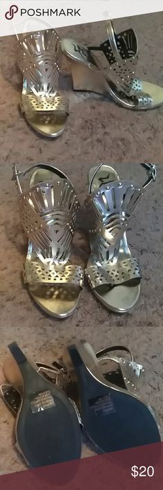 LFL gold shoes size 8 1/2 Beautiful gold wedges never worn. lfl Shoes Wedges