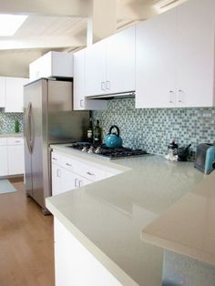 Love white cabinets, backsplash, and cesarstone counters, but needs a white fridge. Down with stainless steel :(