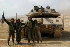 Israeli tankers with their Merkava Mk 4 main battle tank