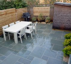 Nice grey patio area with table and chairs and a bbq for all those summer parties and family gatherings. Garden completed by our member Groundteam Limited, see more of their great work here - https://www.experttrades.com/trade/groundteam-limited/gallery  #garden #patio #paving #bbq #gardenfurniture #garden #home #inspiration