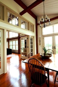 great use of interior windows to keep wall and pass-through open and airy, courtesy Post & Beam Living