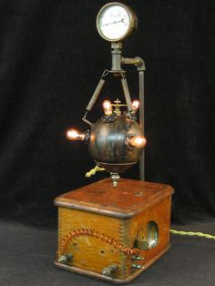 Steampunk Diabolical Box 14. $575.00, via Etsy.  Awesome steampunk lamp! (And I'm not that big a steampunk person...)