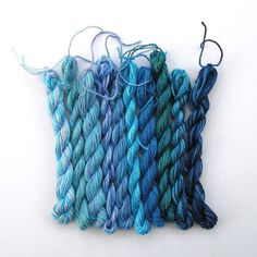 blue wool , different colours