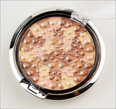 Physicians Formula Light Bronze Pearl Mineral Glow Pearls.   Works great as a highlighter.