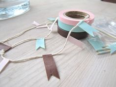 masking tape garland - super simple. Also could use on skewers for little flags for cakes/cupcakes.  Electrical tape would be good too and comes in bright colors.
