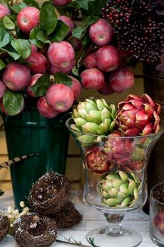 Stunningly gorgeous fall arrangement with artichokes and apples