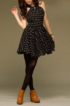 The dress has a halter-style front with gathered detail, a wide fitted waistband with dots printing.