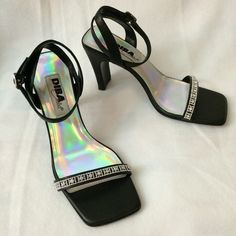Black Diba sandals. Black sandals with a front rhinestone accent. 4 inch heels. Few nicks on the heels and the front. All nicks are shown in additional pictures in another listing. Please check all pictures before you buy. Diba Shoes Sandals