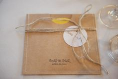 favor packaging - blank DVD with note to post back all pics taken. make DVD envelope by printing on Kraft + fold + sew