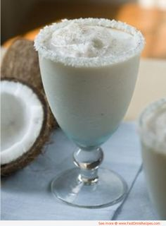 frozen irish cream cocktail | 2 oz. Baileys Irish Cream  1-1/2 oz. Bacardi light rum  2 oz. Coconut water  1/2 cup of half-and-half  1 banana (diced and frozen if possible)  1/2 cup of ice  Nutmeg for garnish  Shaved coconut to rim glass