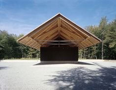 Forest Lodge.  Dethier Architecture.  Roof supported by two truss systems angled w/bracing to form a gable roof with a secondary structure resting above.