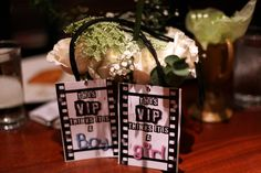 We had an Oscars-type theme, and the centerpieces were white roses with baby's breath and eucalyptus, courtesy of the amazing florist at Flowers & Things, as well as some accent awards that I hand painted to give them a more rustic edge that complimented the restaurant that we had the event at. And everyone wore their opinion around their necks, thanks to these backstage passes we made.