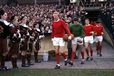Denis Law leads Man Utd out at Hillsborough at the FA Cup Semi Final showdown with Leeds Utd in March 1965.