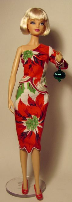 Barbie doll dress made from vintage poinsettia hankie - http://media-cache-ak0.pinimg.com/originals/2f/a4/cb/2fa4cbde366fb5b95262b95a4d957771.jpg