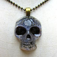 DIY Resin Skull Pendant Tutorial from Dollar Store Crafts here.This project uses the Dollar Store skull ice cube tray.