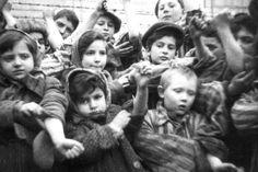 auschwitz - Children who survived Auschwitz show their tattooed identification numbers(Reuters)