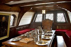 okay, so just imagine that the bench that wraps around just goes straight across (the table wouldn't be there) and then you can kinda see it like a wall-to-wall bed underneath the windows.  maybe we should put some big wooded brackets on the walls to fake the pirate ship effect.