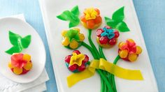 Create this easy edible centerpiece for your table, or top your cake with this colorful fruit flavored snack bouquet!