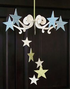 Paper chandelier http://www.etsy.com/listing/26495590/chandelier-in-a-box-shooting-star