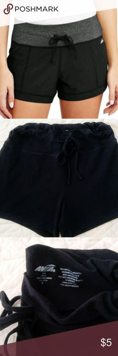 Women's Avia Running Shorts from Wal-Mart Simple, stretchy all black short shorts that are perfect for jogs or yoga. Drawstring, no pockets.   The shorts I am selling are similar to the stock photo but not exact. The waist is not as thick on my gently used shorts. Color is a bit faded from washing but these shorts still have a lot of life left in them. I can't fit them anymore and I'm cleaning out the clutter as I prepare to move next year. Avia Shorts