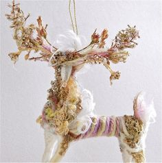 Not sure if this one actually has any beads, but isn't he glorious?  Reindeer Ornament  handmade one of a kind  by JanDanielleDesigns, $43.00