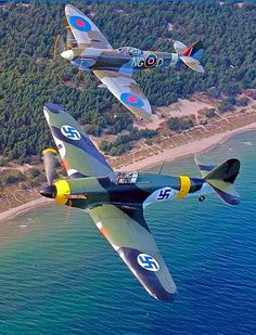 A British Spitfire and a Hawker Hurricane in Finnish colors. Hawker Hurricane, Airplanes, Fighter Jets, Aircraft, British, Military, Colors, Planes, Aviation