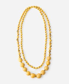 Yellow is one of our favorites colors of the moment, and this necklace makes the color shine with natural tagua, acai and pambil seed.