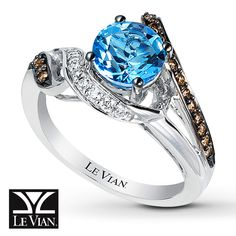 A round Ocean Blue Topaz™ is embraced by spirals lined with Chocolate Diamonds® and Vanilla Diamonds® in this Sinuous Swirl™ ring from Le Vian®. Crafted of 14K Vanilla Gold®, the ring has a total diamond weight of 1/4 carat. Le Vian®. Discover the Legend. Diamond Total Carat Weight may range from .23 - .28 carats.  Topaz is  commonly subject to enhancement processes or treatments such heating, irradiation and diffusion, which may not be permanent and...
