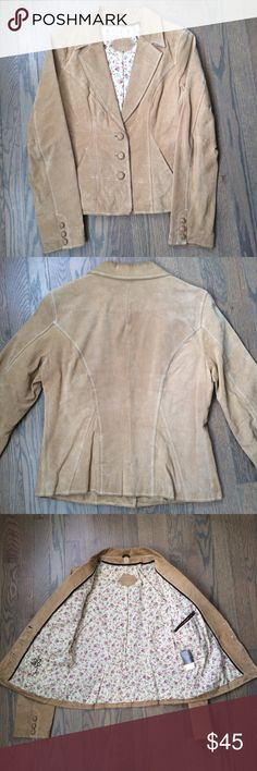 Wilsons Leather Blazer Jacket Gorgeous Wilsons Leather blazer jacket! Genuine leather. Great color. Lined with fun floral fabric. 2 interior pockets and 2 exterior pockets. Stylish blazer cut with front buttons. Perfect Spring jacket! Wilsons Leather Jackets & Coats Blazers