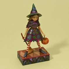 "Jim Shore Halloween 2011  WITCH WAY TO CANDY?    Complimenting the ghost from 2010, this little girl is dressed for the season. Metal handle on pumpkin.    Specifications:  Materials: Stone Resin   Size: 6.875""H x 2.25""W x 3.5""L  Note: Unique variations should be expected; Hand painted.    Your Price: $28.50"