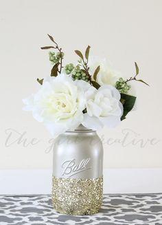 Dip mason jars in glitter for a fun, vintage DIY wedding piece.