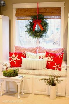 window seat with wreath and christmas decor in master bedroom