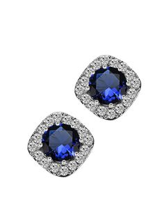 *Free shipping worldwide* Vintage appeal make these halo earrings irresistibly chic, featuring an intense synthetic sapphire surrounded by a bevy of cubic zirconia. | bridal earrings | wedding earrings | bridesmaid earrings | prom earrings | silver earrings | sapphire blue earrings | bridal jewelry | wedding jewelry | prom jewelry | bridal jewellery | wedding jewellery | prom jewellery