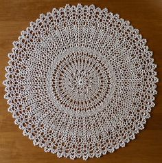 """August"" from Leisure Arts #3455 ""A Year of Doilies Book 4"" a Patricia Kristoffersen design.  DMC Cebelia Crochet Cotton, Size 10 color: #Ecru  17 inches using a size 5 (1.90mm) steel hook"