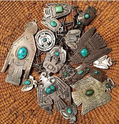 Vintage Native American sterling silver and turquoise pendants and brooches. Thunderbirds, arrows, animals, etc.