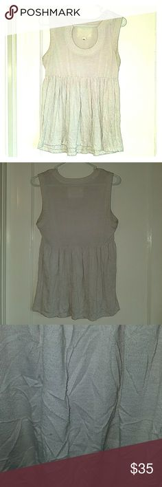 Charming & Unique Anthropologie Blouse This sleeveless blouse is one of a kind! Has a very unique neckline and a flattering empire waist. It's sort of an eggshell color and a size M. Very good used condition. The brand is Deletta but bought from Anthropologie. Anthropologie Tops