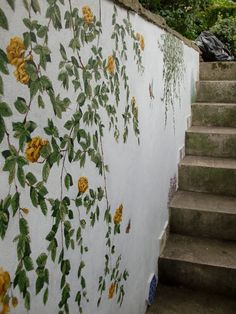This is a mural painted on a staircase in a garden leading to Primrose Hill, London