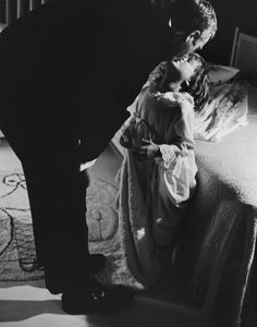 Steve McQueen kisses his daughter Terry goodnight at their home in Hollywood, CA in 1963.