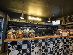 Sea Point's artisan coffee house, Bootlegger Coffee Company, is so popular that local property developers have been known to use its proximity as a lure for buyers. Featuring dark grey walls, golden light fittings and vintage type, the design is hip and welcoming.