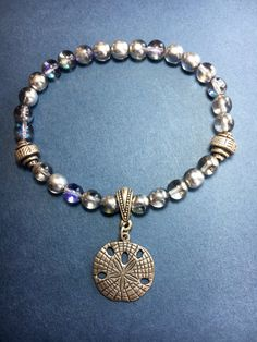 Sand Dollar Charm and Czech Metallic Blue-Violet by AnjiandCo
