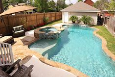 Another view of the pool and the two car detached garage.  Backyard has two grassy areas for child's or pets play.