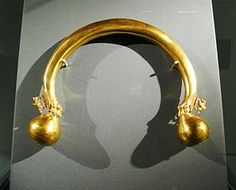 A unique 24 carat Celtic torc, whose ends are adorned with winged horses on intricate filigree pedestals and lion paws, inspired by Etruscan, Scythian or Middle Eastern bestiary.