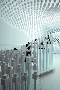 """A Pop-Up Scent Shop Made From The Perfumes On Sale. This tiny temporary space is hung with ghostly white bottles cast in gypsum cement. Rather than overwhelming visitors with gimmicks, Mustonen and Arsham say they hope the shop will offer consumers """"a few minutes to contemplate this strange white-on-white landscape inhabited by only a few products."""""""