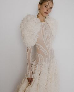 An oyster ruffle sleeve and hem panelled dress in ivory lichen lace, cotton tulle and washed organza. The fabric for this dress is… Alexander Mcqueen, Kaia Gerber, Tutu, Tweed, Sarah Burton, Haute Couture Gowns, Mode Plus, Panel Dress, Slow Fashion