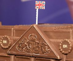 CONFECTIONARY giant Cadbury has unveiled a new creation to honour the Queen's birthday – a model Buckingham Palace made completely from CHOCOLATE. Queen 90th Birthday, Chocolate Fountains, Buckingham Palace, Christmas Ornaments, Holiday Decor, Christmas Ornament, Christmas Topiary, Christmas Decorations