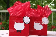 For her daughter's Hello Kitty party, a customer came up with this nifty idea for tweaking the party bags to suit the little boys who would be at the party.  Say hello to Mr. Kitty!  She asked if we could change the hair bow on the kitty medallion to be a black bow tie and then change the background of the tag to match.  Of course we could, and are so glad we did. #hellokittyparty